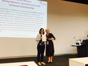 Dr Juliet Watson winning the AWGSA PhD Prize from president JaneMaree Maher